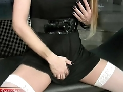 Blue eyed sultry T-girl with peppery hair is masturbating