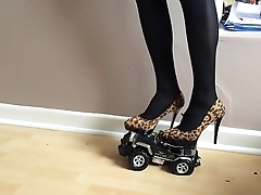Toy car crushed under high heels