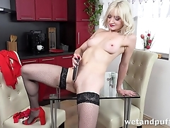 Erotic blonde in stockings pleases herself with dildo