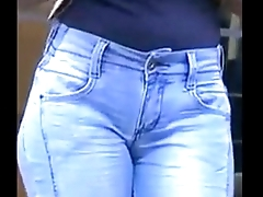 Talkative brunette in close-fisted jeans pants